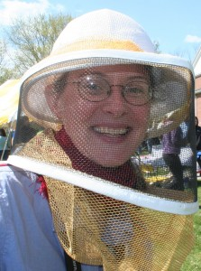 Kaat shows off the latest beekeeper's fashions at Earth Day. (photo Peg Mallett)